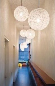 Long corridor with several round white lights hanging