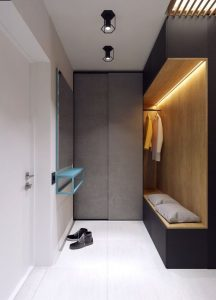 small hallway with a grey dressing and led lighting