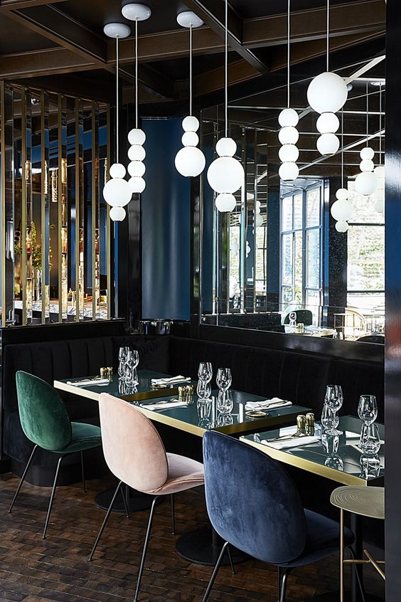 restaurant art deco style with dark wall and velvet chairs