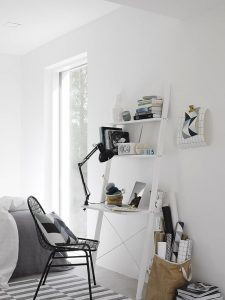 white leaning desk in a living room