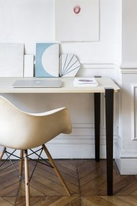desk with black metallic legs and eames chair