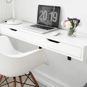 White shelf with two drawers as a desk