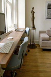 wood shelf as desk along a window