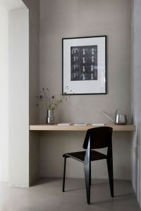 Built-in wooden desk with a black chair