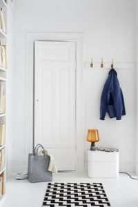 yellow glass table lamp in a white hallway