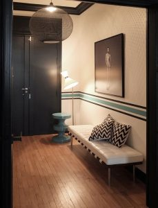 dark entrance of an apartment with a round ceiling lamp