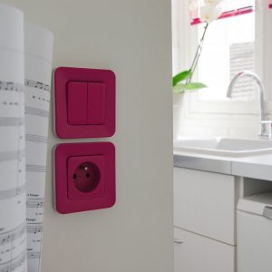 Pink switcher in a white kitchen